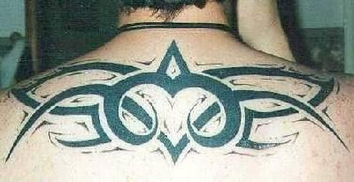 Big tribal tattoo on upper back