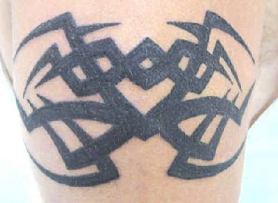 Simple small black tribal tattoo