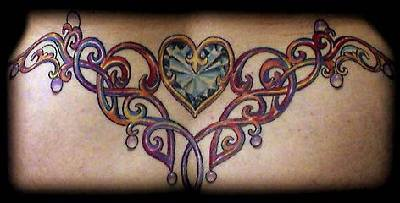 Colorful tribal tattoo with heart on lower back
