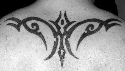 Simple tribal tattoo on upper back