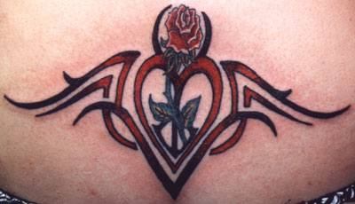 Tribal sign tattoo with red heart and rose