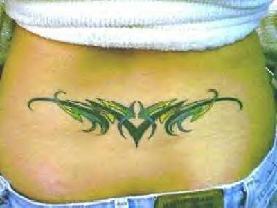 Three colored tribal tattoo on lower back