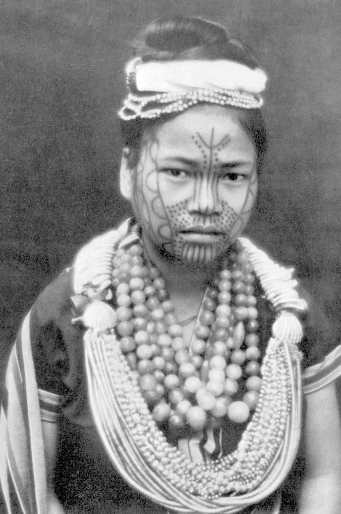Dots tribal tattooed face