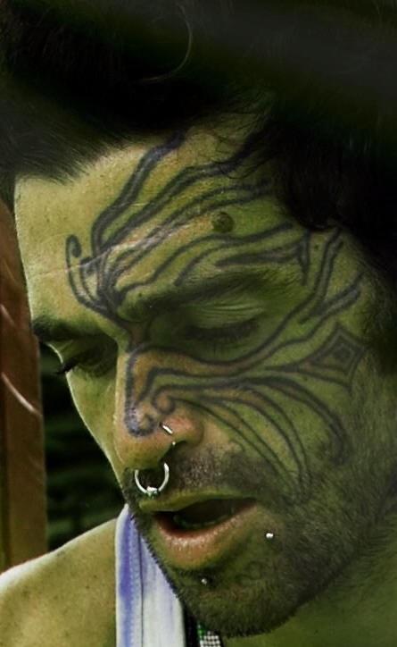 Tatuaggio radice in stile tribale