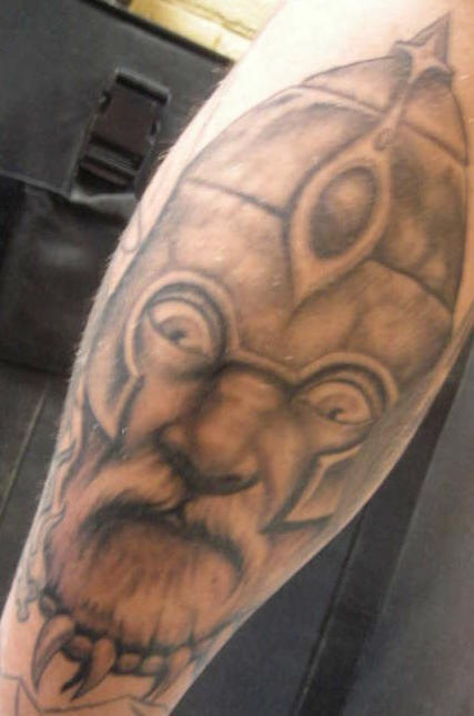Viking warrior with big eyes in helmet  tattoo