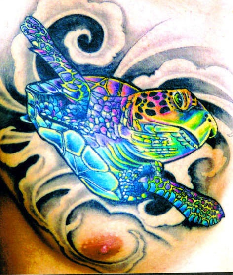 Chest tattoo with full colored turtle