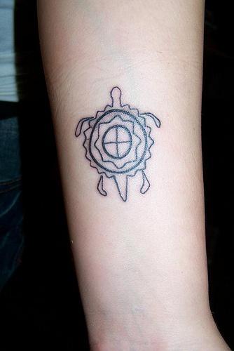 Small turtle tattoo in interesting design
