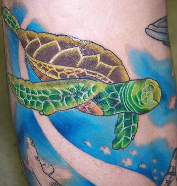 Colorful seabed tattoo with green turtle