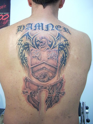 On upper back warrior  with  shield and  flags tattoo