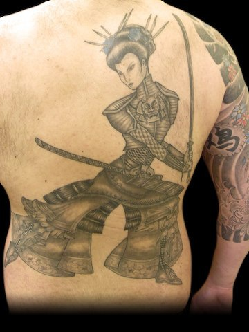 Geisha tattoo harsh fighting  on upper back