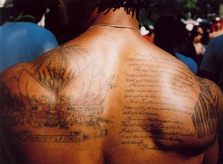 La force on upper back people  around palm tattoo