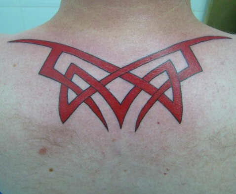 On upper back red image tattoo with sharp edges