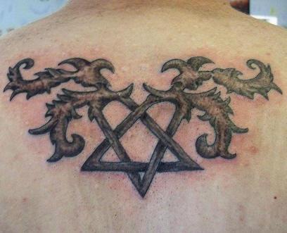 Crossed  locks on upper back  tattoo decorated