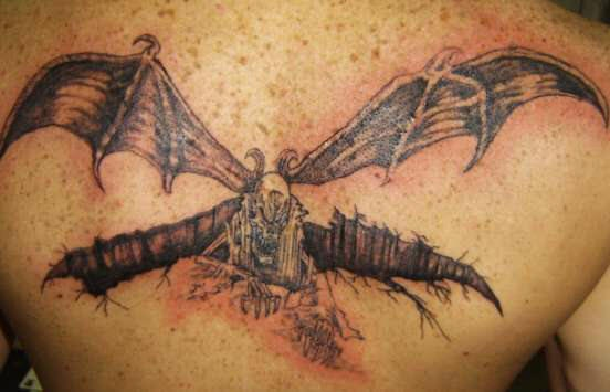 On upper back evil flying devil-bat tattoo