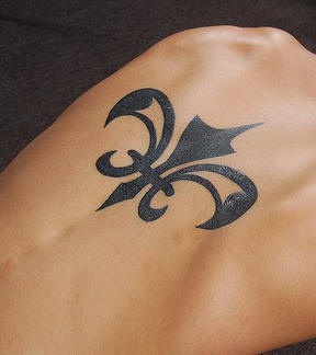 Iron flower  tattoo black  image on upper back