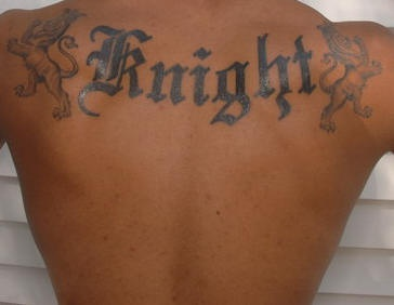 Knight styled tattoo inscription on upper back