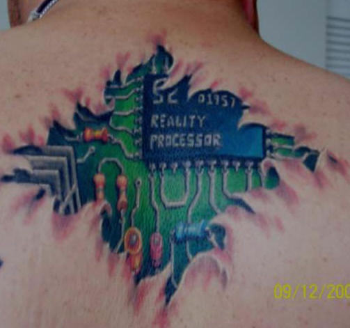Mechanical tattoo reality processor  on upper back