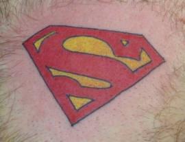 Superman symbol coloured tattoo