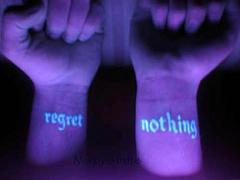 Regret nothing uv ink tattoo