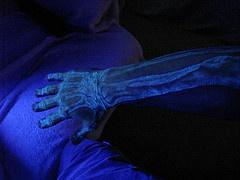 Arm bones uv ink tattoo on arm