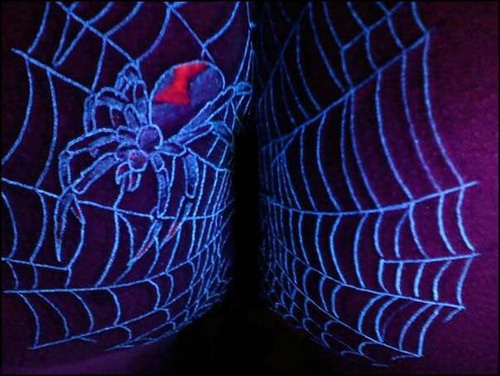 Spider in web glowing tattoo