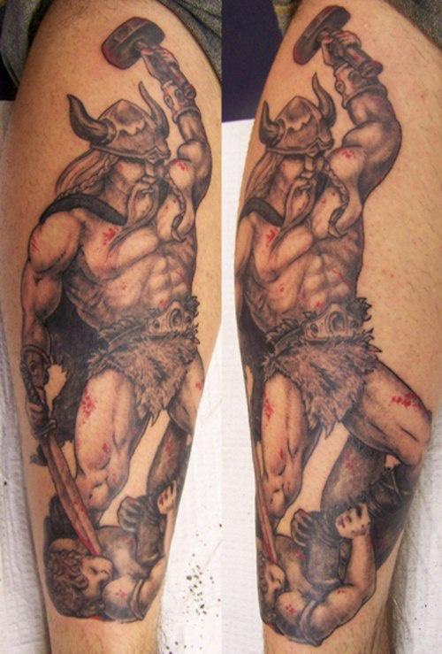 Big powerful viking warrior with hammer tattoo