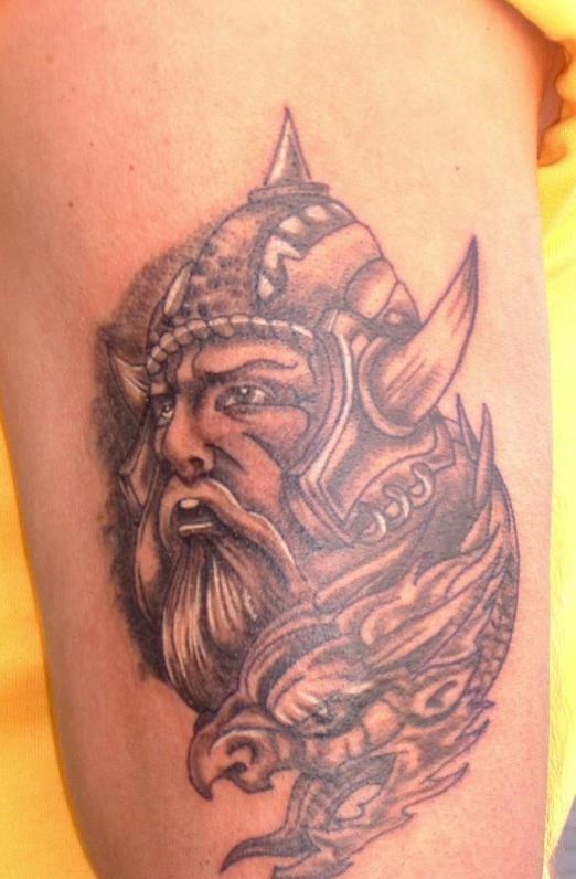 Viking warrior head tattoo with dragon head