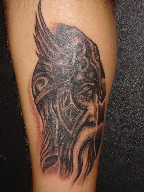 Viking warrior on winged helmet tattoo