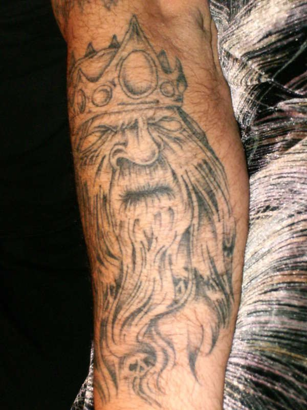 Viking king tattoo with crown on his head