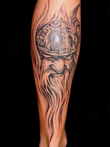 Viking head in helmet with long beard tattoo