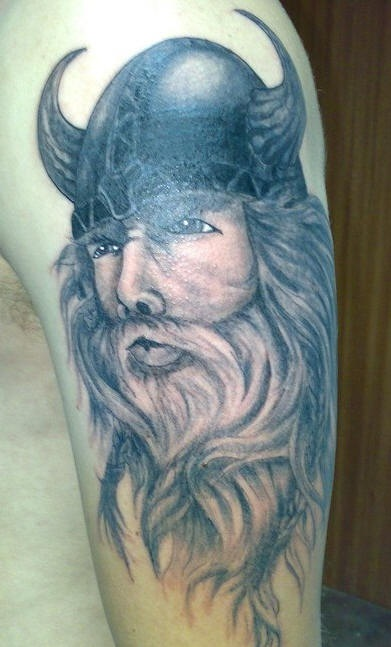 Handsome viking in horned helmet tattoo