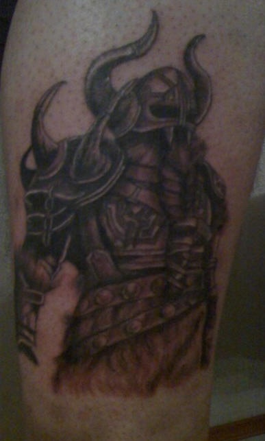 Strong viking warrior in dark armor tattoo
