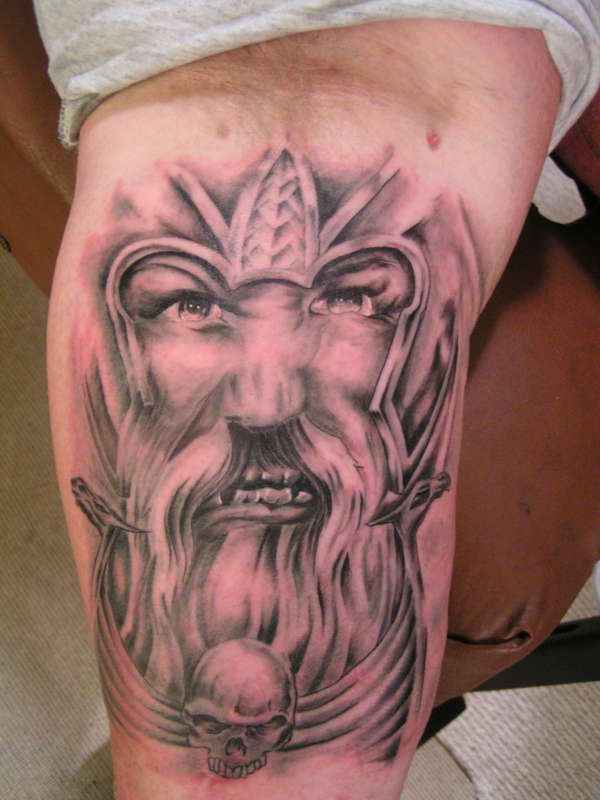 Angry viking warrior face on tattoo