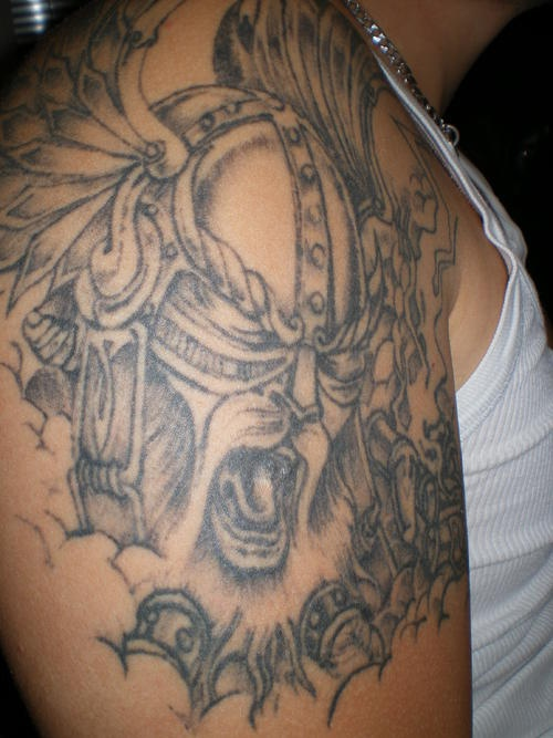 Viking tattoo of crying warrior in helmet