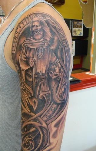 Big viking hand tattoo with sad warrior