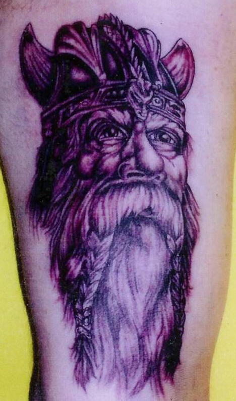 Viking tattoo of old warrior with braids on mustache