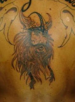 Shaggy viking warrior in horned helmet tattoo