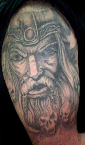 Serious viking warrior with braids on mustache tattoo