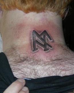 Black viking sign tattoo on back neck