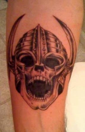 Viking tattoo of angry skull in helmet