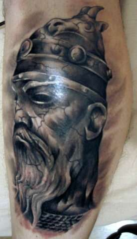 Dark black ink viking tattoo with warrior head