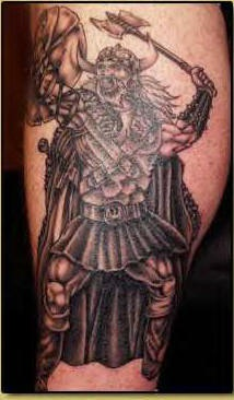 Tattoo of viking warrior attacks with axe