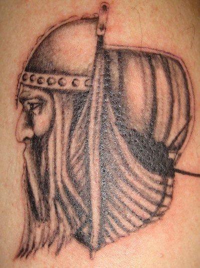 Black viking and ship tattoo