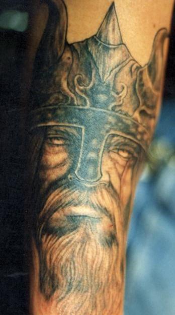 Viking in helmet with the beard portrait tattoo