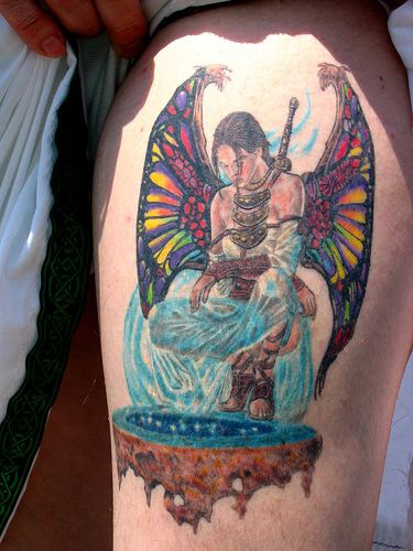 Colorful viking tattoo with winged girl