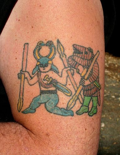 Tattoo with warriors on hand
