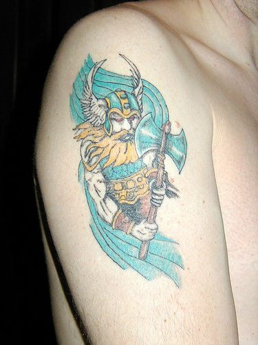 Colorful shoulder tattoo of viking in winged helmet