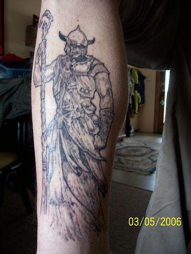 Black tattoo of viking in full length