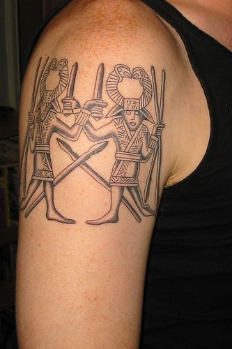 Shoulder tattoo with two warriors