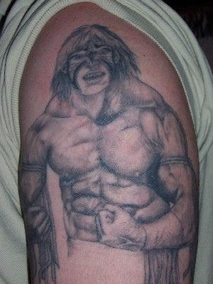 Muscular viking tattoo on the shoulder